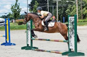 "Here, Anna and I were ""in the moment"" and the exercise became easy and fun-- like bring on the playground is supposed to be! Photo Credit Lauren Atherton Eventing"