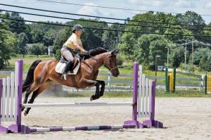 """Staying focused when the unexpected happens (like clearly missing your distance) takes practice and """"mental toughness"""".  Photo Credit Lauren Atherton Eventing"""