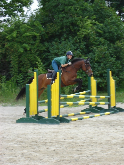 Anna and I schooling July 2011.  To date, I am the only rider to ever school her over fences.