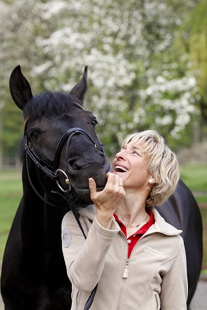 Ingrid with her now retired Olympic eventing horse, FRH Butts Abraxxas.  Her love of horses is evident here, I think.  Photo has been taken from her website, www.klimke.org