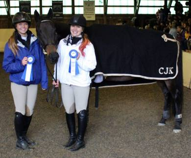 My horse Lee and two UNH IHSA team members, each of whom won a flat class on her at the home show.