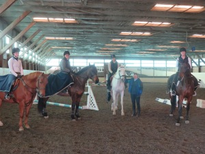 UNH students riding school owned horses Clementine, Whisper and Morocco participated in a clinic with UNH graduate Nancy Guyotte.